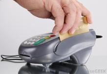 credit-card-being-swiped-through-a-terminal
