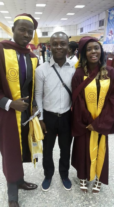 Ayodele Daniel Dada, with another graduate, Ikwuazo Chinwe who also made a first class with 4.68 score.Photo Posted by Aregbesola Temitope(middle)