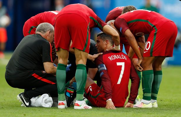 Ronaldo comforted by team mates