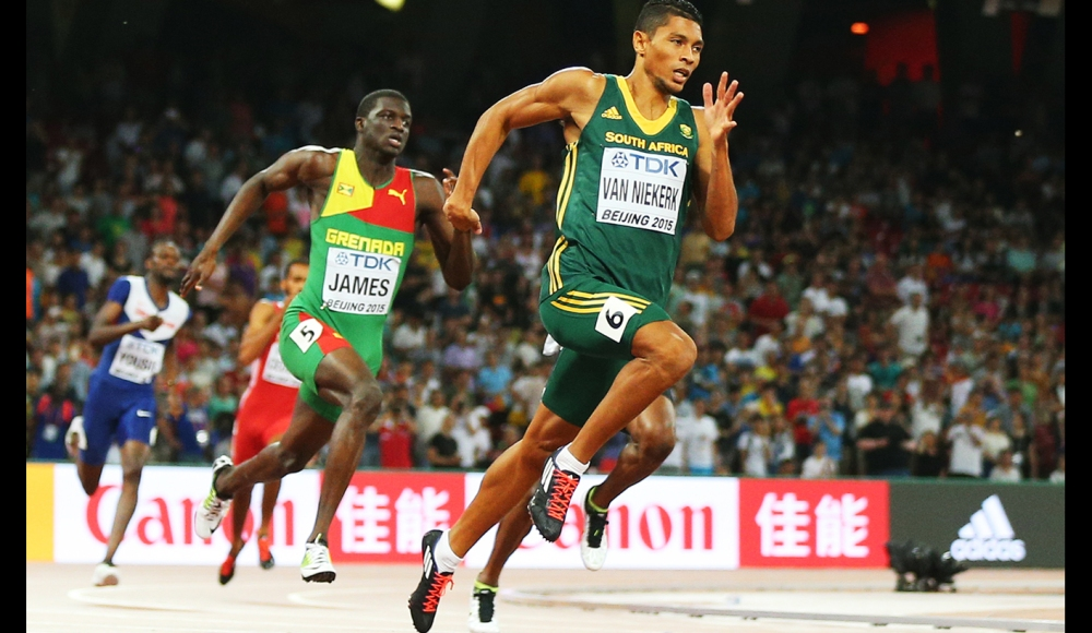 epa04898996 Wayde Van Niekerk of South Africa on his way winning the men's 400m final during the Beijing 2015 IAAF World Championships at the National Stadium, also known as Bird's Nest, in Beijing, China, 26 August 2015.  EPA/WU HONG