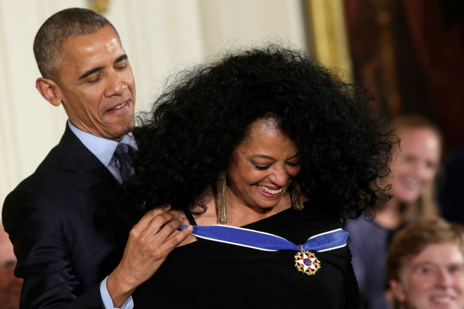 Diane Ross receives her medal from Obama